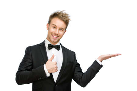 Half-length portrait of thumbing up business man with palm up, isolated on white. Concept of leadership and success photo