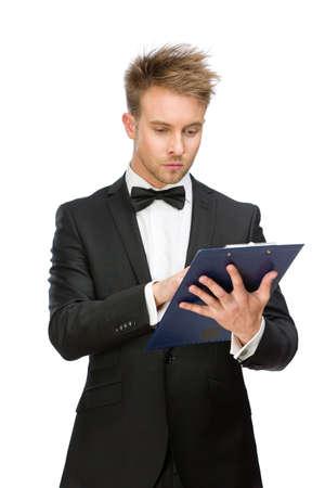 Half-length portrait of businessman reading something in folder, isolated on white photo