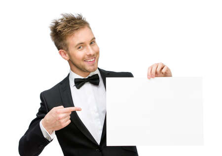 Half-length portrait of businessman keeping and pointing at copyspace, isolated on white photo