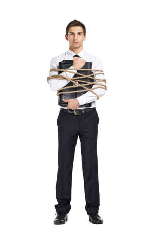 servitude: Full-length portrait of businessman handing briefcase who tied with the line, isolated on white. Concept of slavery and violence