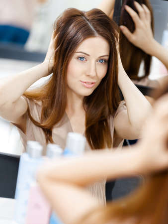 Reflection of the hairstyle of the female client in mirror. Concept of fashion and beauty