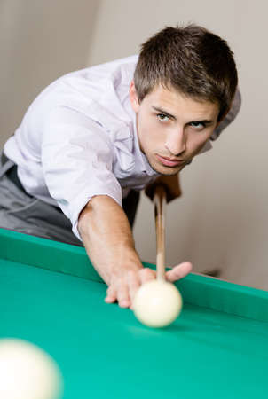 Male playing billiard. Spending free time on gambling Stock Photo - 26665787