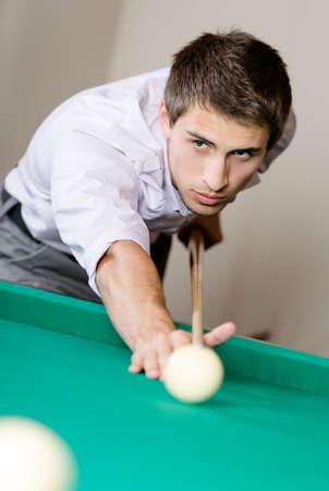Male playing billiard. Spending free time on gambling Stock Photo - 26665787