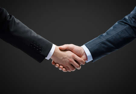 Close up shot of handshake of business people. Concept of trustworthy relations and business cooperation Stock Photo - 26693322