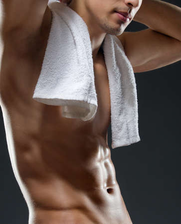 Close up of sportsmans torso, isolated on black photo