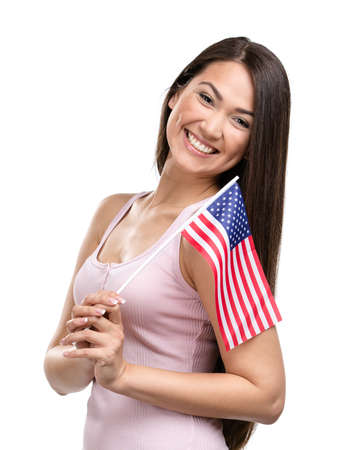 Half-length portrait of female handing American flag, isolated on white photo