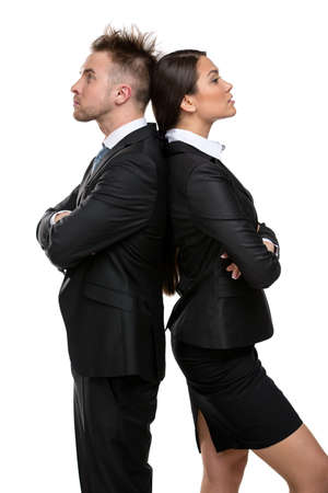 Profile of two businesspeople stands back to back with their arms crossed, isolated on white. Concept of competition and job competitive promotion photo