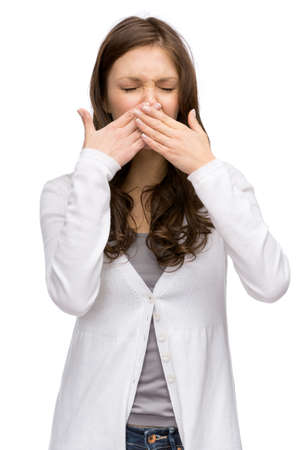 Portrait of woman with closed eyes covering her nose, isolated on white. Concept of stink and disgust photo