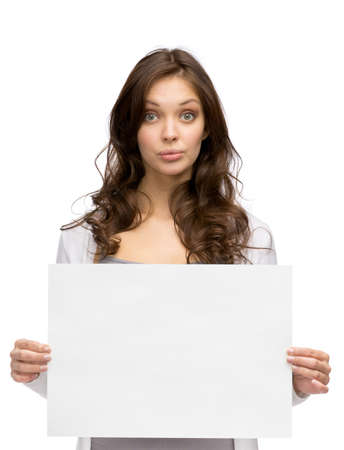Half-length portrait of serious woman handing copyspace, isolated on white photo