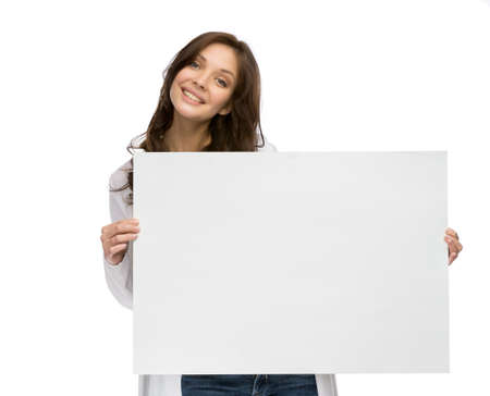 Half-length portrait of smiley woman keeping copyspace, isolated on white photo