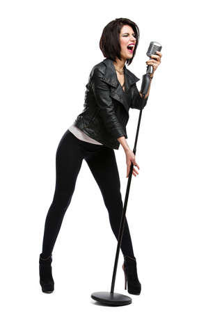 full metal jacket: Full-length portrait of rock musician wearing leather jacket and keeping static microphone, isolated on white. Concept of rock music and rave Stock Photo