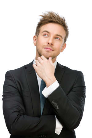 Half-length portrait of pensive executive touching face, isolated on white. Concept of leadership and success photo