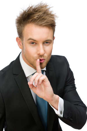 shush: Half-length portrait of businessman silence gesturing, isolated on white. Concept of secret and mystery Stock Photo