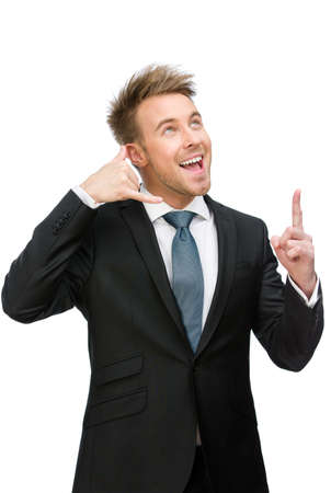 Half-length portrait of businessman telephone gesturing who points with finger, isolated on white. Concept of communication and contact