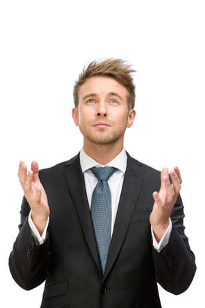 Half-length portrait of business man praying with hands up, isolated on white. Concept of hope and belief photo