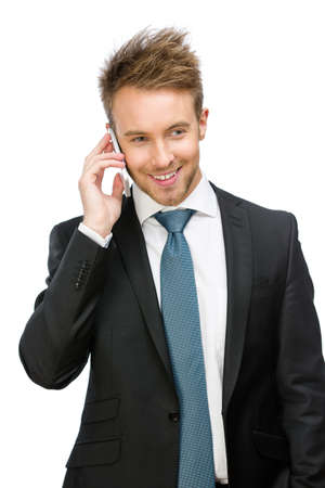 Half-length portrait of businessman speaking on cell phone, isolated on white Stock Photo