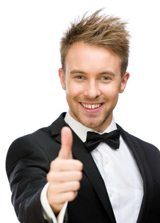 Portrait of businessman who thumbs up, isolated on white. Concept of leadership and success photo