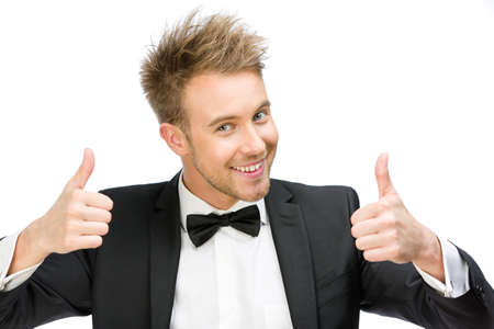Portrait of manager who thumbs up with two hands, isolated on white. Concept of leadership and success photo