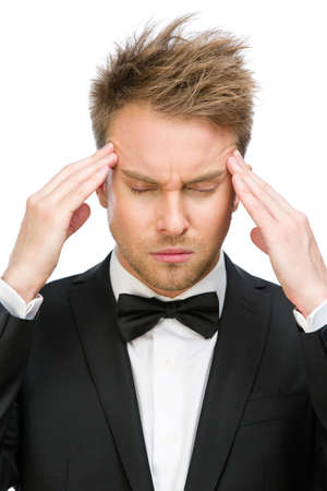 achy: Portrait of business man with closed eyes putting hands on head, isolated on white. Concept of headache and high temperature Stock Photo