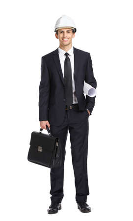 Full-length portrait of engineer in helmet handing blueprint and bag, isolated on white. Concept of construction and  engineering photo