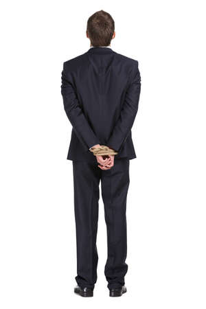 Full-length portrait of businessman with tied hands, isolated on white. Concept of slavery and hard work photo