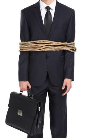 servitude: Portrait of businessman tied with the rope, isolated on white. Concept of slavery and violence Stock Photo
