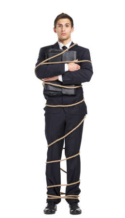 servitude: Full-length portrait of businessman handing briefcase who bound with the rope, isolated on white. Concept of slavery and violence