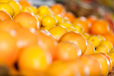Close up of pile of oranges. Concept of healthy food photo