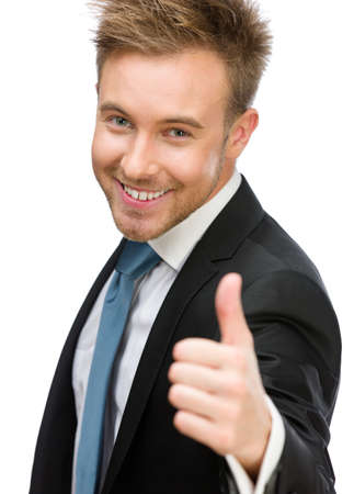 Half-length portrait of executive who thumbs up, isolated on white. Concept of leadership and success photo