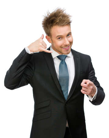 adult intercourse: Half-length portrait of businessman phone gesturing who points with finger, isolated on white. Concept of communication and contact Stock Photo