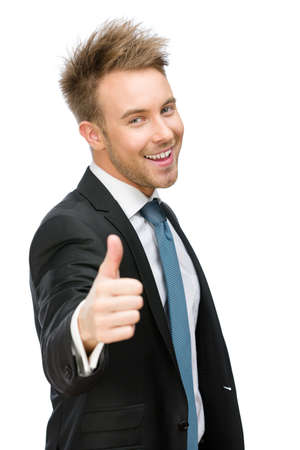 Half-length portrait of businessman who thumbs up, isolated on white. Concept of leadership and success photo