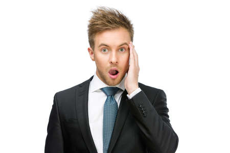 hysterics: Half-length portrait of amazed businessman with open mouth who touches face, isolated on white Stock Photo