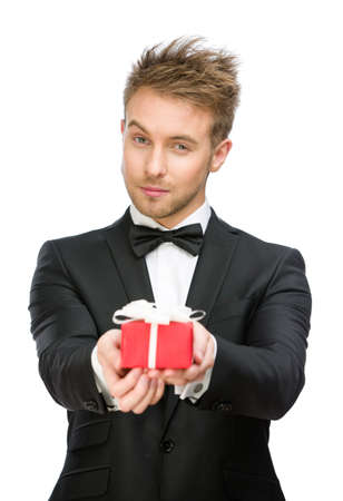 Half-length portrait of businessman holding present box, isolated on white. Concept of holidays and gifts photo