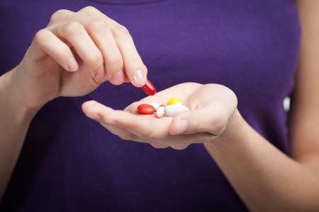 Woman takes antibiotics, isolated on white. Taking medication