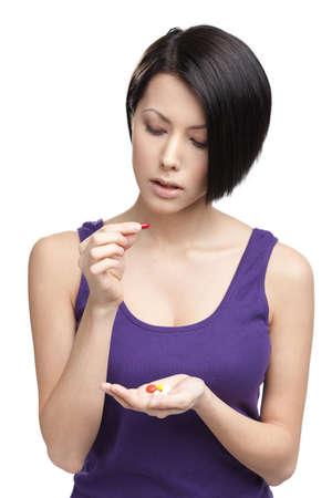 antidepressant: Woman takes antidepressants, isolated on white. Taking medication Stock Photo