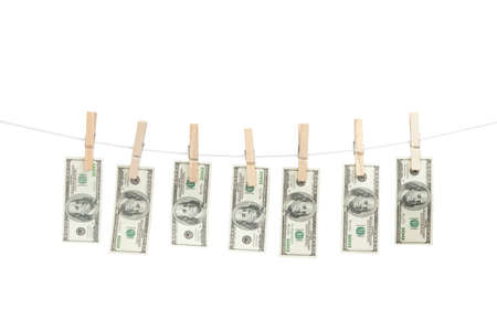 Line of money hanged with clothespins, isolated on white photo