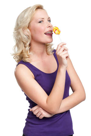 Woman licking round lollypop, isolated on white Stock Photo - 29733956