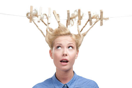 horizontal haircut: Woman with creative haircut of clothespins, isolated on white