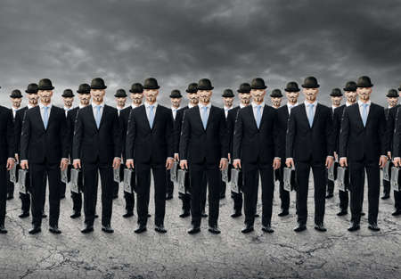 servitude: Group of business people standing in a raw - routine concept Editorial