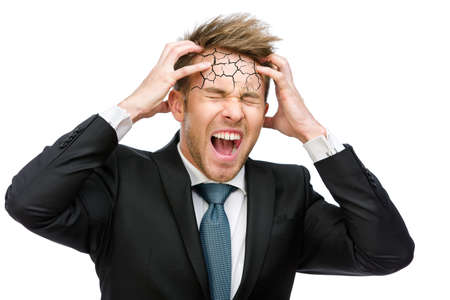 Half-length portrait of businessman putting hands on cracked head and shouting, isolated on white. Concept of headache, stress and high temperature