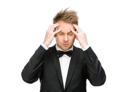 Half-length portrait of businessman with closed eyes putting hands on head, isolated on white. Concept of headache and high temperature Stock Photo