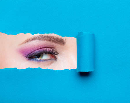 Close up of woman eye with pink make-up. Concept of fashion and beauty. photo