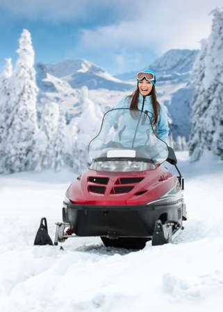 snowmobile: Portrait of woman on snowmobile. Concept of snow sport and healthy lifestyle Stock Photo