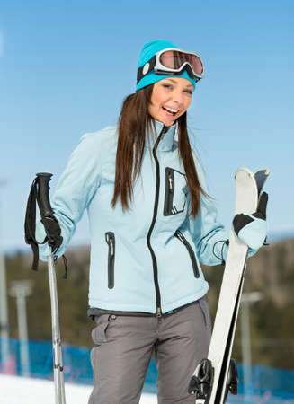 Half-length portrait of female alpine skier. Concept of winter sports and cute entertainment photo