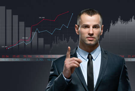 infochart: Young businessman with infochart on black background