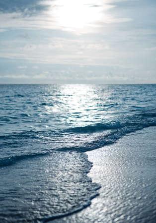 romantic sky: Maldivian sunset on a beach overlooking the ocean