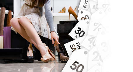 Female legs and variety of shoes in the footwear shop. Black Friday sale photo