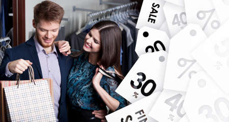Attractive woman and young man go shopping at the store on sale photo