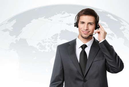 Operator puts earphones with microphone, international talks Stock Photo