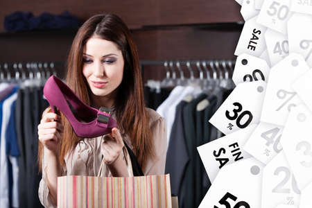 Woman stares at excellent fuchsia shoes at shopping center at a good price Stock Photo